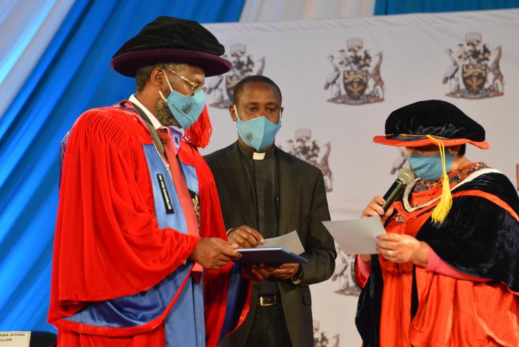 The Vice Chancellor receiving the Universities standards and guidelines, 2014